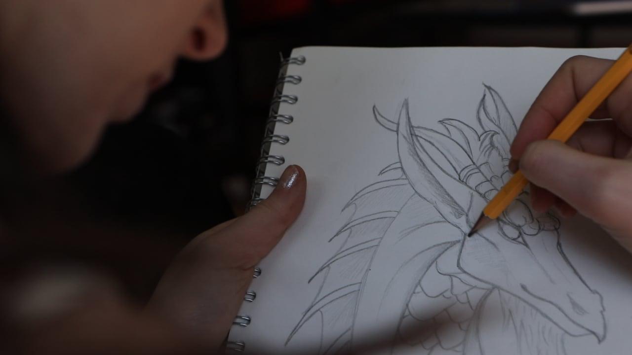 Artist Sketching Ancestral Dragon